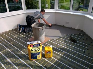 installation of underfloor electric heating by Michael Atkinson Flooring